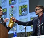 Robert Downey Jr extends a rose to Josh Brolin