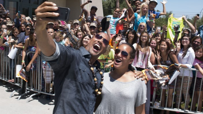 Say cheese for The Rock's selfie.