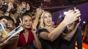 Brie Larson takes a selfie with fans